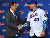 Wilson Ramos, newly-signed New York Mets catcher, right, shakes hands with general manager Brodie Van Wagenen during Ramos' introductory news conference at Citi Field in Flushing. NY on Tuesday, Dec. 18, 2018.