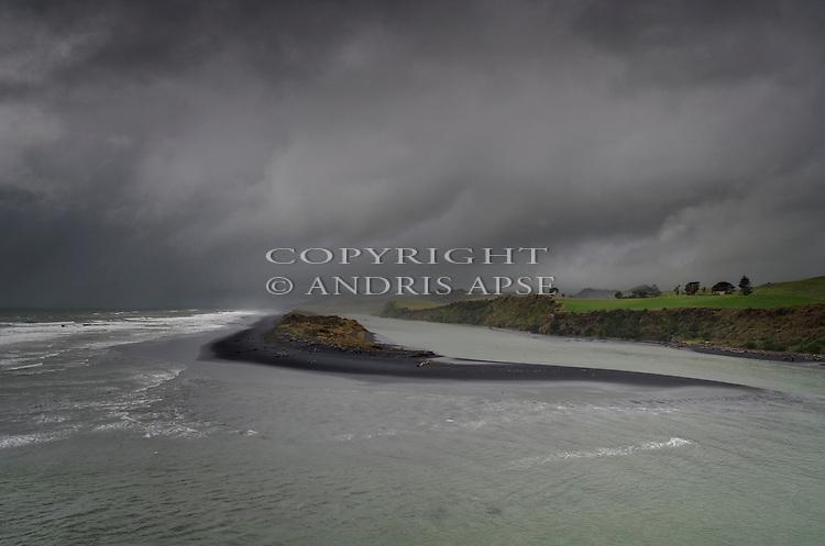 Storm clouds over Awakino Heads. Taranaki Region. New Zealand.
