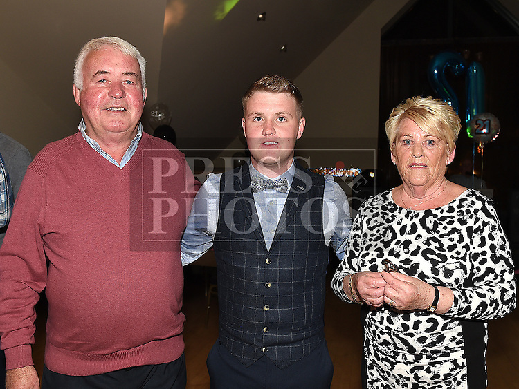 Jamie Brannigan celebrating his 21st birthday in the Thatch with grandparents Eugene and Ann O'Callaghan. Photo:Colin Bell/pressphotos.ie