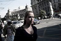 ROMANIA / Bucharest /06.10.2009 / A young woman in front of The University of Bucharest in University Square or Piata Universitatii.  © Davin Ellicson / Anzenberger