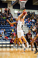 Springdale Bulldogs vs Bentonville West Woverines Basketball - Collin Blackburn of Bentonville West goes up with the ball as Vincent<br />