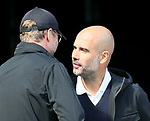 Jurgen Klopp manager of Liverpool greets Josep Guardiola manager of Manchester City during the premier league match at the Etihad Stadium, Manchester. Picture date 9th September 2017. Picture credit should read: David Klein/Sportimage