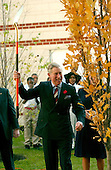 Washington, D.C. - November 2, 2005 -- Charles, the Prince of Wales clowns with a shovel used to plant a tree during a visit to the School of Education Evolution and Development (SEED) School during a visit with his wife, Camilla, the Duchess of Cornwall, in Washington, D.C. on November 2, 2005.  The SEED School is a public charter boarding school..Credit: Ron Sachs / CNP.(Restriction: No New York Metro or other Newspapers within a 75 mile radius of New York City)