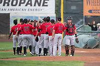 The Billings Mustangs bullpen wishes good luck to catcher Pabel Manzanero (47) before a Pioneer League game against the Ogden Raptors at Lindquist Field on August 17, 2018 in Ogden, Utah. The Billings Mustangs defeated the Ogden Raptors by a score of 6-3. (Zachary Lucy/Four Seam Images)