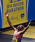 Meb Keflezighi, of San Diego, Calif., celebrates his victory during the 118th Boston Marathon on Boylston Street in Boston on Monday, April 21, 2014.Photo by Christopher Evans
