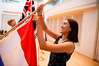 Volunteers assemble flags on stage before the opening ceremony of the 11th USA International Harp Competition at Indiana University in Bloomington, Indiana on Wednesday, July 3, 2019. (Photo by James Brosher)