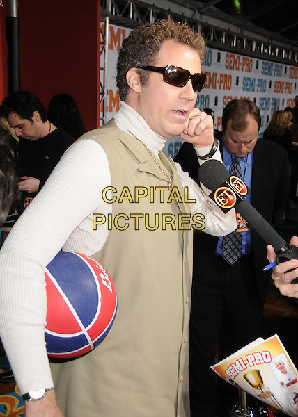 "WILL FERRELL.""Semi-Pro"" Los Angeles Premiere at Mann's Village Theatre, Westwood, California, USA..February 19th, 2008.half length white polo neck turtleneck sunglasses shades basketball ball microphone interview.CAP/ADM/BP.©Byron Purvis/AdMedia/Capital Pictures."