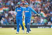 MS Dhoni (India) discusses with Jasprit Bumrah (India) during India vs Australia, ICC World Cup Cricket at The Oval on 9th June 2019