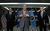 United States President George W. Bush speaks to the media after visiting the Office of the Director of National Intelligence and the National Counterterrorism Center (NCTC) in McLean, Virginia, on December 8, 2008. With Bush is NTCT Director Mike Leiter (L) and  Director of National Intelligence Mike McConnell (R).  <br /> Credit: Roger L. Wollenberg / Pool via CNP