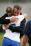 25 October 2009: Duke's Jane Alukonis (5) is hugged by head coach Robbie Church during Senior Day festivities. The Duke University Blue Devils defeated the Virginia Tech Hokies 4-1 at Koskinen Stadium in Durham, North Carolina in an NCAA Division I Women's college soccer game.