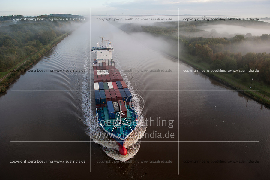 Germany , container ship in Kiel canal going from North sea to Baltic Sea