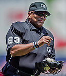 31 May 2014: MLB Umpire Laz Diaz gets replenished with baseballs during a game against the Texas Rangers at Nationals Park in Washington, DC. The Nationals defeated the Rangers 10-2, notching a second win of their 3-game inter-league series. Mandatory Credit: Ed Wolfstein Photo *** RAW (NEF) Image File Available ***
