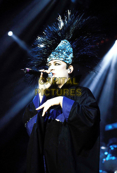 BOY GEORGE.Ref: 9198.concert, live, stage, costume, hat, headpiece, singing, half length, half-length.www.capitalpictures.com.sales@capitalpictures.com.© Capital Pictures