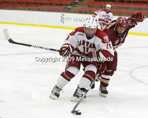 Daniel Moriarty (Harvard - 11), Matt Price (BC - 25) - The Boston College Eagles defeated the Harvard University Crimson 3-2 on Wednesday, December 9, 2009, at Bright Hockey Center in Cambridge, Massachusetts.