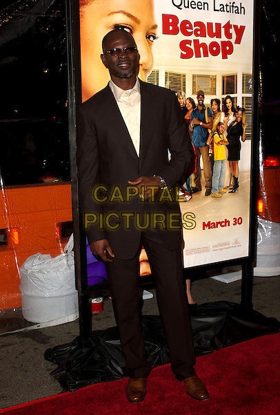 "DJIMON HOUNSOU.MGM's World Premiere of ""Beauty Shop"" held at The Mann National Theater in Westwood, California.March 24th, 2005.full length brown suit.www.capitalpictures.com.sales@capitalpictures.com.Supplied By Capital PIctures"