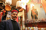 Portrait of a merchant in his shop in Tunis, Tunisia.