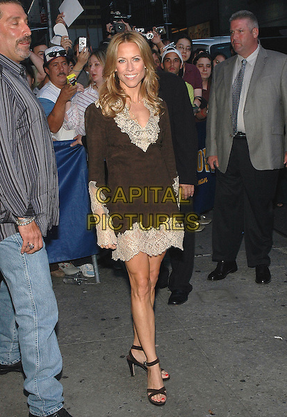 SHERYL CROW .Signs autographs for her fans after taping an appearance at the Dave Letterman show in Manhattan, New York, New York. .Photo Credit: Patti Ouderkirk/AdMedia/Capital Pictures.Ref: PO/ADM/CAP.full length brown dress lace trim .www.capitalpictures.com.sales@capitalpictures.com.© Capital Pictures.