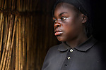 Bora Namutu- aged 18yrs.  Bora was raped in the night in her family hut by rebels.  She had a son called Aganzi, a product of the rape.  Rebels come down at night to raid the villages, rape and abduct women.  <br />