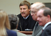 Prince William County (Virginia) Circuit Court Judge LeRoy F. Millette, Jr., talks to attorneys as the jury begins deliberations for a second day in the penalty phase of convicted sniper John Allen Muhammad's murder trial at the Virginia Beach Circuit Court in Virginia Beach, Virginia on Monday November 24, 2003. <br /> Credit: Davis Turner - Pool via CNP