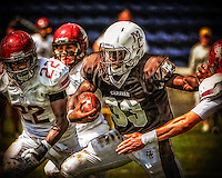 Mt. Carmel's Jaquan Buntyn breaks through the St. Joseph line for a long gain Sunday at Toyota Park in Bridgeview
