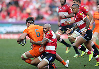 Pablo Matera (captain) of the Jaguares tackled by Lionel Mapoe of the Emirates Lions during the Super Rugby quarter-final match between the Emirates Lions and the Jaguares at the Emirates Airlines Park Stadium,Johannesburg, South Africa on Saturday, 21 July 2018. Photo: Steve Haag / stevehaagsports.com