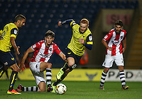 Jordan Storey of Exeter City fails to tackle Ryan Taylor of Oxford United during the The Checkatrade Trophy match between Oxford United and Exeter City at the Kassam Stadium, Oxford, England on 30 August 2016. Photo by Andy Rowland / PRiME Media Images.