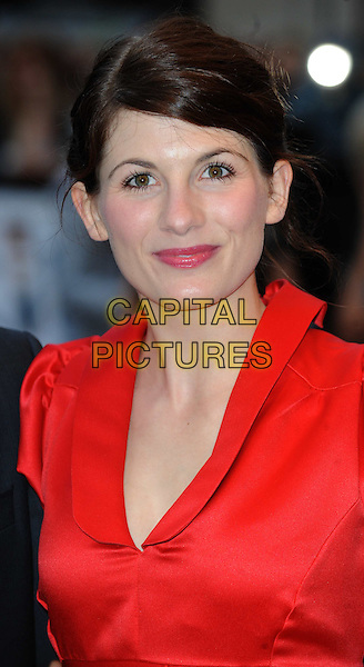 JODIE WHITTAKER.'The Kid' UK premiere held at the Odeon West End, Leicester Square, London, England. .15th September 2010 .headshot portrait red silk satin collar .CAP/WIZ.© Wizard/Capital Pictures.
