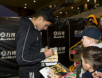 4th January 2020; Molineux Stadium, Wolverhampton, West Midlands, England; English FA Cup Football, Wolverhampton Wanderers versus Manchester United; Raul Jimenez of Wolverhampton Wanderers signing autographs before the match - Strictly Editorial Use Only. No use with unauthorized audio, video, data, fixture lists, club/league logos or 'live' services. Online in-match use limited to 120 images, no video emulation. No use in betting, games or single club/league/player publications