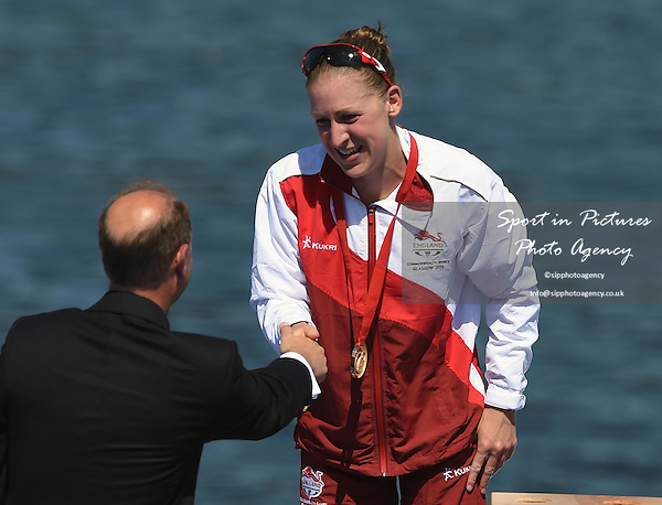 Jodie Stimpson (ENG) celebrates winning the gold medal in the Women's Triathlon at the 2014 Commonwealth Games. The first medal to be awarded at the games. <br /> PHOTO: Mandatory by-line: Garry Bowden/SIPPA/Pinnacle - Tel: +44(0)1363 881025 - Mobile:0797 1270 681 - VAT Reg No: 183700120 - 240714 - Glasgow 2014 Commonwealth Games - Strathclyde County Park, Glasgow, Scotland, UK