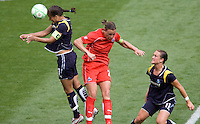 LA Sol's Shannon Boxx and Washington Freedom's Abby Wambach battle. The LA Sol defeated the Washington Freedom 2-0 in the opening game of Womens Professional Soccer at Home Depot Center stadium on Sunday March 29, 2009.  .Photo by Michael Janosz