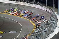 18-19 February, 2016, Daytona Beach, Florida USA<br /> Grant Enfinger and Austin Theriault lead the field through the first turn.<br /> ©2016, F. Peirce Williams