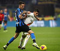 Calcio, Serie A: Inter Milano - AS Roma, Giuseppe Meazza stadium, December 6, 2019.<br /> Inter's Matias Vecino (l) in action with Roma's Diego Perotti (r) during the Italian Serie A football match between Inter and Roma at Giuseppe Meazza (San Siro) stadium, on December 6, 2019.<br /> UPDATE IMAGES PRESS/Isabella Bonotto