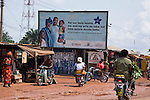 A billboard in the heart of a market in Enugu displays a family planning message developed by Nigeria's largest indigenous NGO, the Society for Family Health, in partnership with the Nigerian Ministry of Health and financed by the US Agency for International Development (USAID).