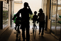 Family returning home after a cycle ride.