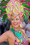 A dancer takes part in the parade of the Copenhagen Latin Carnival.