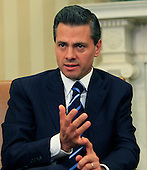 President Enrique Peña Nieto of Mexico makes remarks to the media after meeting with United States President Barack Obama (not pictured) in the Oval Office of the White House in Washington, D.C. on Tuesday, January 6, 2015.<br /> Credit: Dennis Brack / Pool via CNP