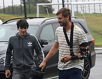 Swansea City's Fernando Llorente (right) arrives with a broken left arm at the training ground for the first day back of the pre season.