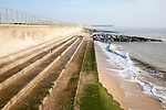 Curved Sea wall, steps and rock armour groynes, forming coastal defences at Southwold, Suffolk, England