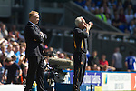 Visiting manager Mick McCarthy (right) becomes animated in the first half at St. Andrew's stadium, during Birmingham City's Barclay's Premier League match with Wolverhampton Wanderers as home manager Alex McLeisdh looks on. Both clubs were battling against relegation from  England's top division. The match ended in a 1-1 draw, watched by a crowd of 26,027.