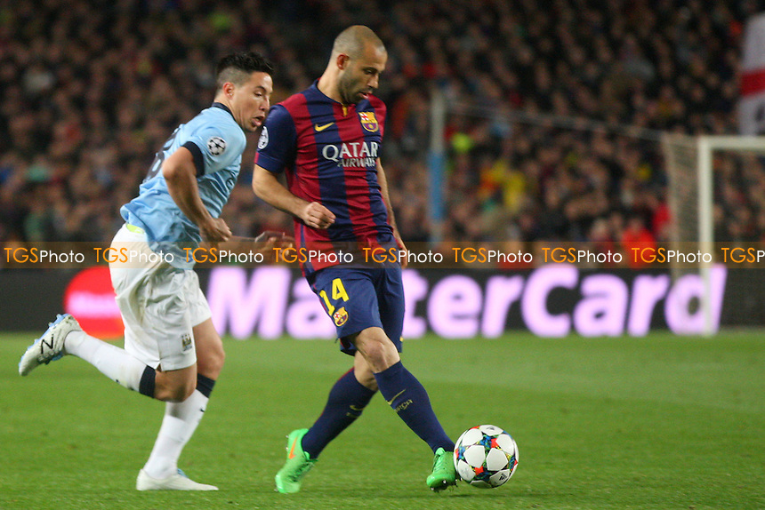 Javier Mascherano of FC Barcelona and Samir Nasri of Manchester City - FC Barcelona vs Manchester City - European Champions League Round of Sixteen Football at the Camp Nou Stadium on  18/03/15 - MANDATORY CREDIT: Dave Simpson/TGSPHOTO - Self billing applies where appropriate - 0845 094 6026 - contact@tgsphoto.co.uk - NO UNPAID USE