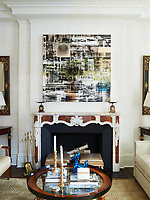 In the living room, above the fireplace a painting by Canan Tolon is flanked by 19th century Italian mirrors. The 1940s cocktail table in front is attributed to Jacques Quinet.