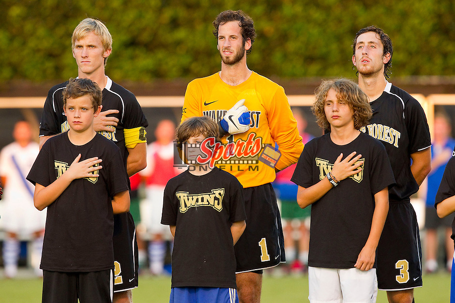 (L-R) Jared Watts (2), Michael Lisch (1) and Anthony Arena (3) of the Wake Forest Demon Deacons with members of a local youth soccer team prior to the match against the Duke Blue Devils at Spry Soccer Stadium on September 21, 2012 in Winston-Salem, North Carolina.  The Demon Deacons and the Blue Devils battled to a 0-0 tie in 2 overtimes.  (Brian Westerholt/Sports On Film)