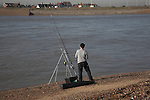 Fishing, River Deben, Bawdsey, Suffolk, England. Looking across to Felixstowe Ferry.