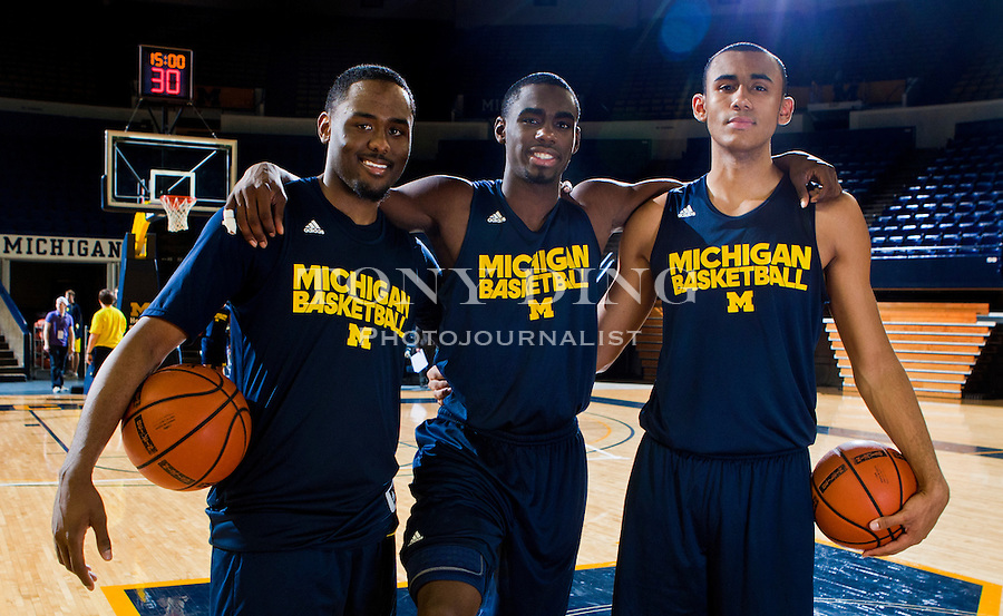 Michigan guards Jordan Dumars, left, and Tim Hardaway, Jr., center, and forward Jon Horford, right, pose for pictures after a team practice, Thursday, Nov. 11, 2010, at Crisler Arena in Ann Arbor, Mich. Hardaway, Jr. is the son of former Miami Heat All-star Tim Hardaway, Dumars is the son of former Detroit Pistons All-star and current President of Pistons Basketball Joe Dumars, and Horford is the son of former Milwaukee Bucks' Tito Horford and brother to the Atlanta Hawks' Al Horford. (AP Photo/Tony Ding)