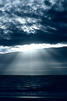 Dramatic lightrays through ocean clouds.<br />