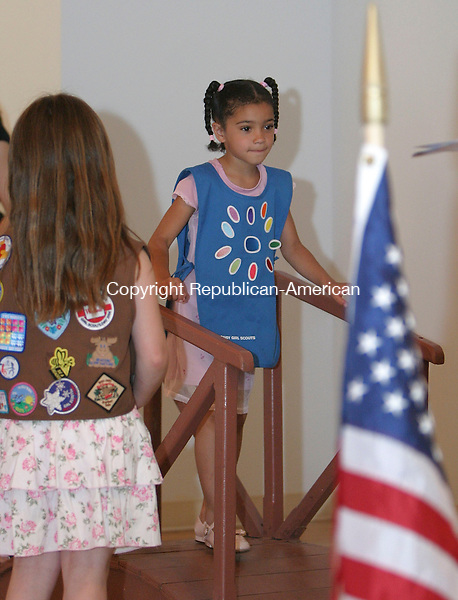 WOLCOTT, CT - 05 June 2005 -060505BZ10- While &quot;Brownie&quot; Amber Marin looks on, left, &quot;Daisy&quot; Simone Wright of Troop #4214 crosses a ceremonial bridge to become a &quot;Brownie&quot; during the Wolcott Girl Scouts 2005 Town Bridging Ceremony held at the Wolcott Congregational Church Sunday afternoon.<br /> Jamison C. Bazinet Photo