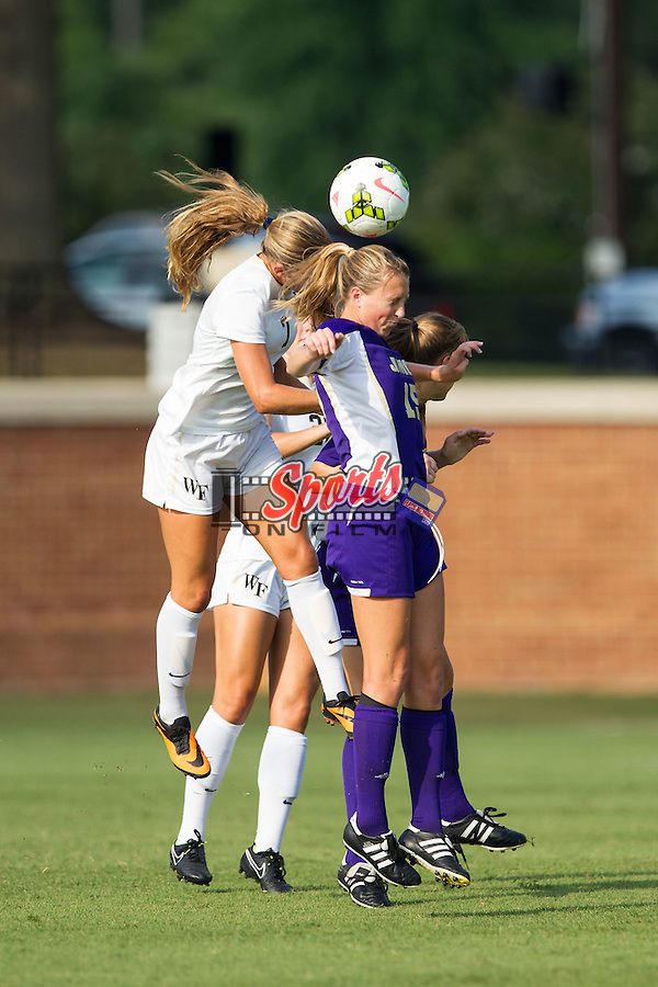 Rachel Ivey (15) of the James Madison Dukes fights for a jump ball with Sarah Teegarden (7) of the Wake Forest Demon Deacons at Spry Soccer Stadium on August 29, 2014 in Winston-Salem, North Carolina.  The Dukes defeated the Demon Deacons 2-1.   (Brian Westerholt/Sports On Film)
