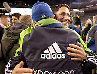 Seattle Sounders FC General Manager Adrian Hanauer, right, gets a hug from co-owner Drew Cary after play between the Seattle Sounders FC and the Chicago Fire in the U.S. Open Cup Final at CenturyLink Field in Seattle Tuesday October 4, 2011. Seattle won the game 2-0 to win its third U.S. Open Cup.