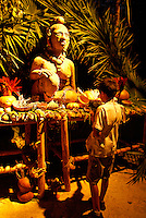 Statue of Ixchel, a Mayan fertility goddess, surrounded by offerings, Xcaret park,  Riviera Maya, Quintana Roo, Mexico