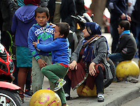 Pictured: Children play in Heyden Street, Victoria Square Tuesday 08 March 2016<br /> Re: Migrants at Victoria Square, in central Athens, Greece.